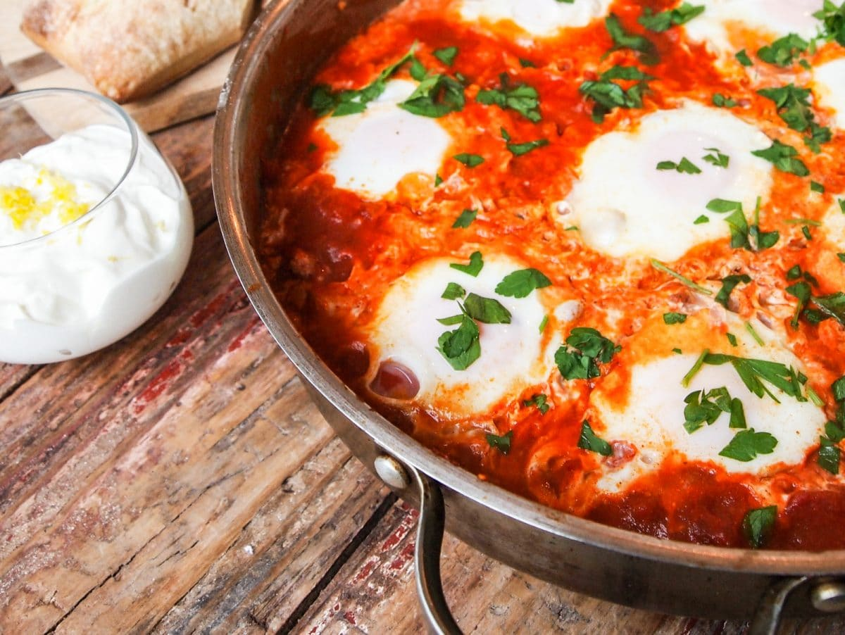 Shakshuka is eggs poached in a tomato sauce. It's a splendid breakfast that will have you soaking up the sauce with bread! #eggs #breakfast #poachedeggs