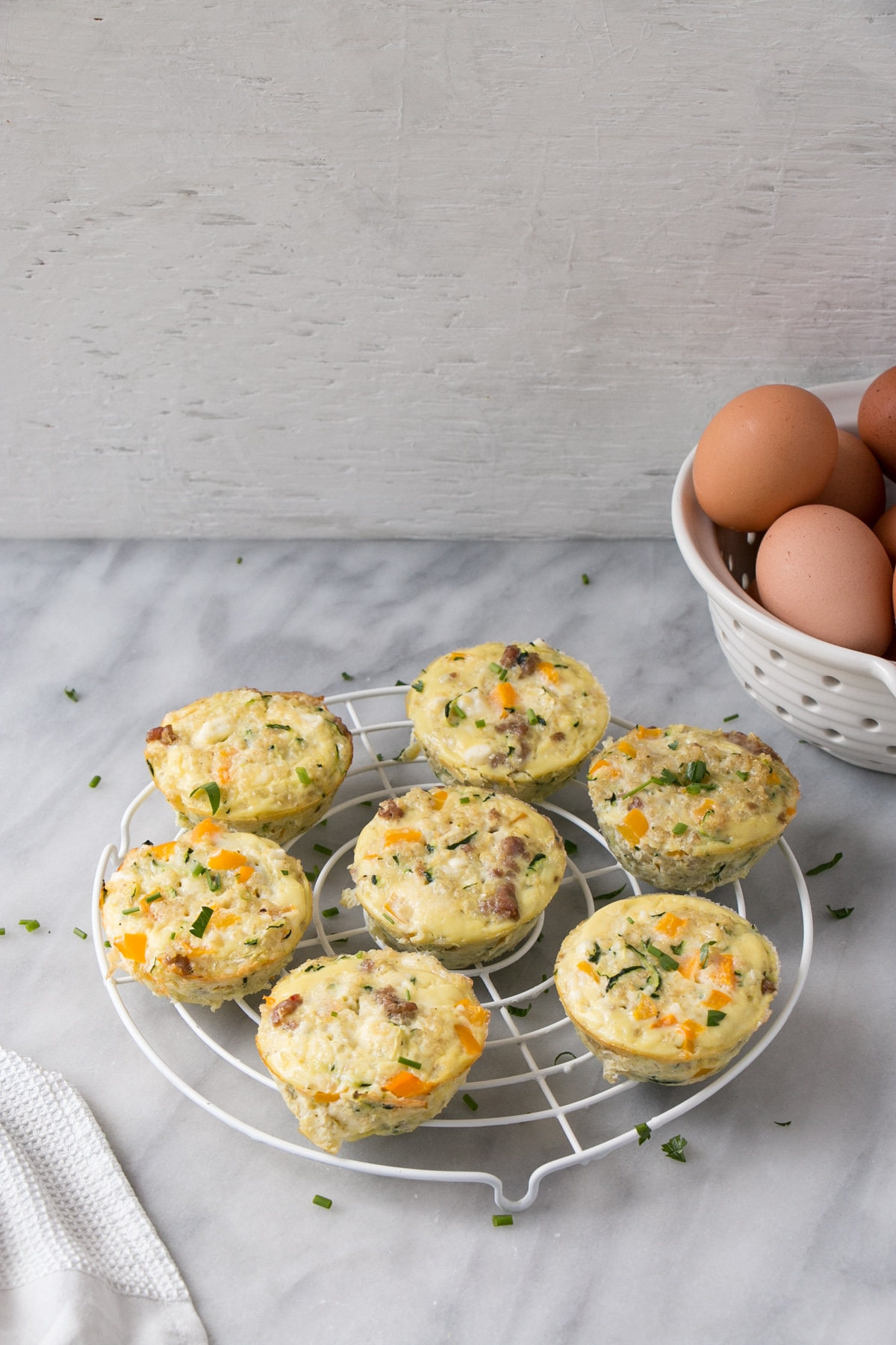 Quinoa Frittata Muffins on a cooling rack