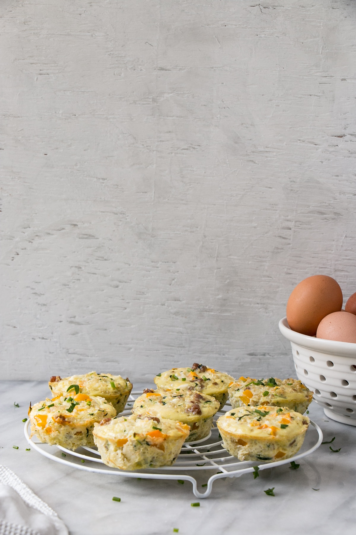 Quinoa Frittata Muffins with eggs in background