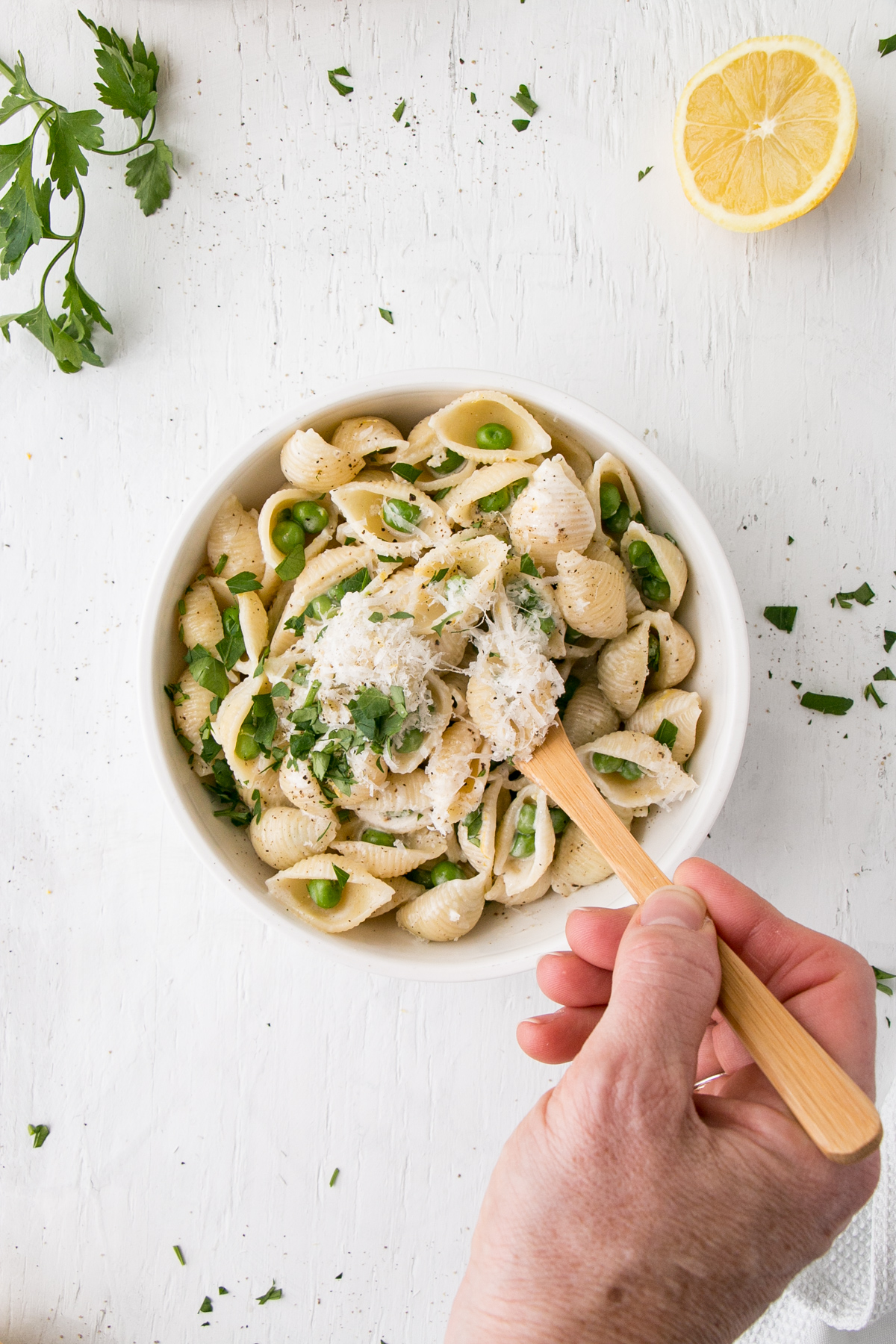 Lemon Pepper Alfredo with Peas in a white bowl