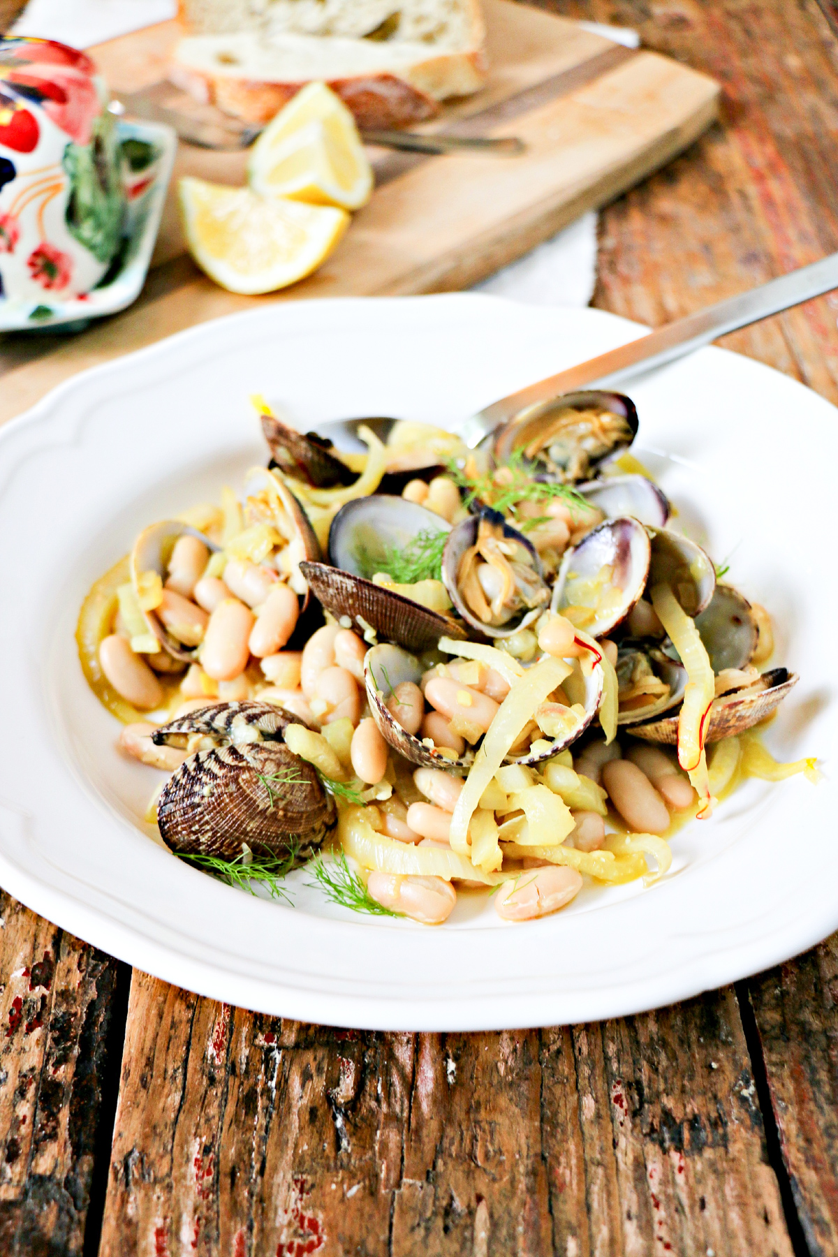Saffron Clams & Fennel with White Beans in a white bowl