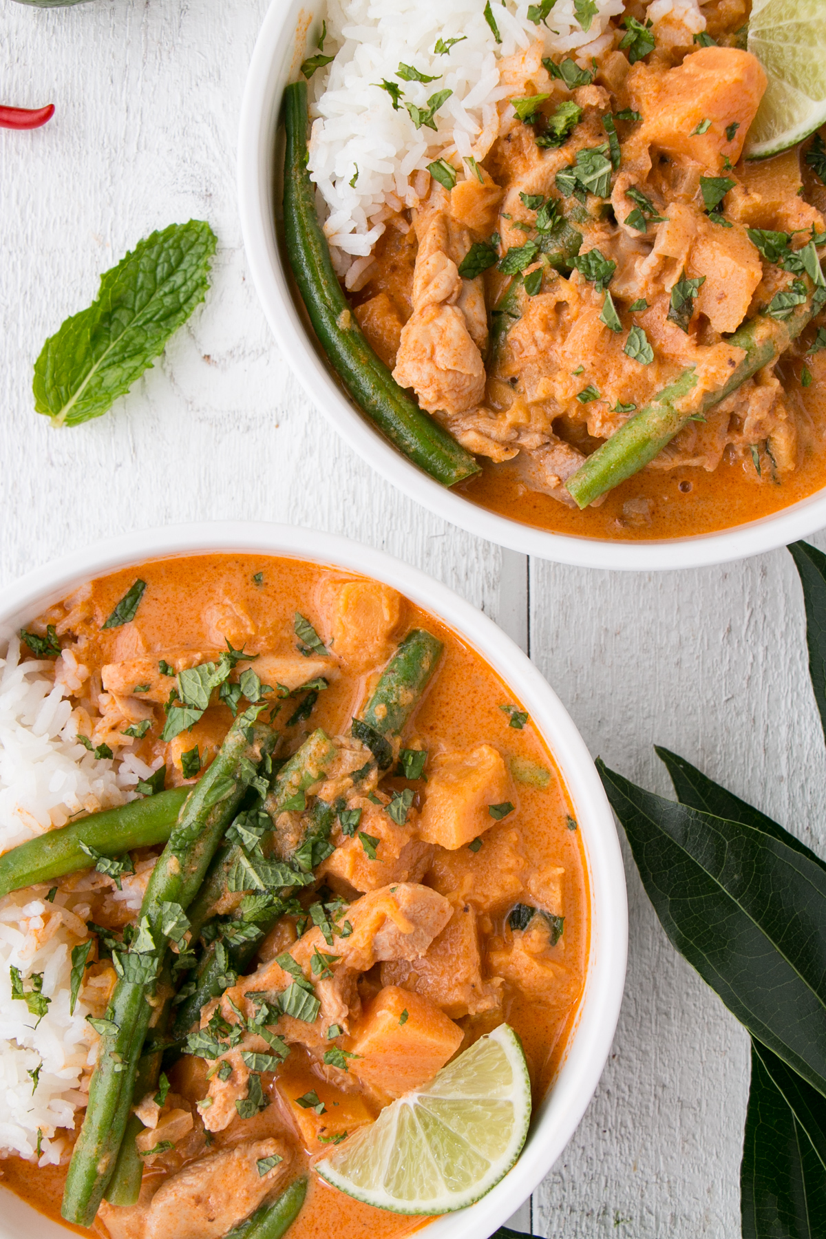 Easy Chicken and Squash Curry in white bowls.