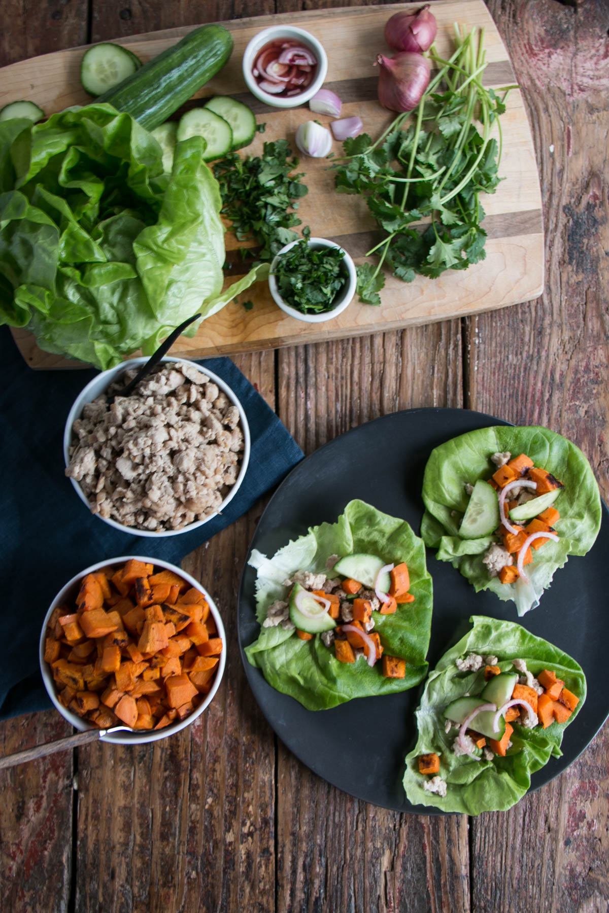 Light, vibrant, and scrumptious Sweet Potato Lettuce Wraps! Delicious Thai Peanut Sweet Potatoes, Chicken, and Pickled Shallots for a refreshing and satisfying meal. #lettucewraps #healthy #sweetpotatoes