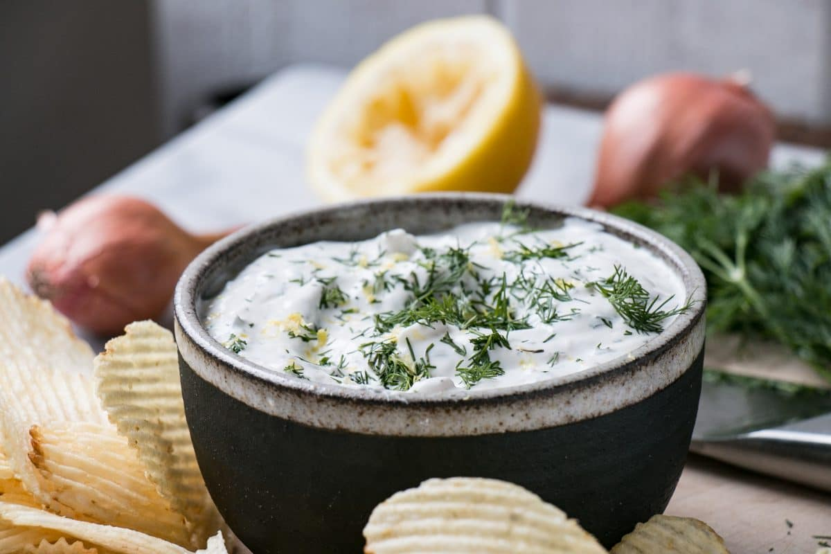 Dilly Shallot Yogurt Chip Dip for the perfect side to chips! Light, lemony, and packed with dill and shallot, this dip won't weigh you down. #dip #gameday #appetizer