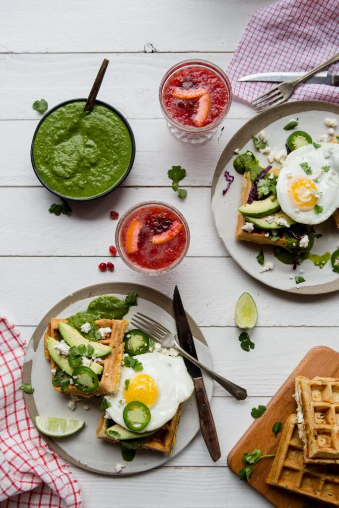 Savoury Mexican Waffles are the answer to all your brunch needs. Filled with corn, cilantro and feta, top with an egg and salsa verde! #waffles #brunch