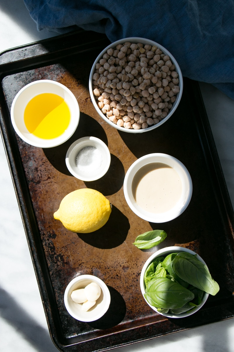 Ingredient prep for Lemon Basil Hummus, such as dried chickpeas, tahini, olive oil, etc.