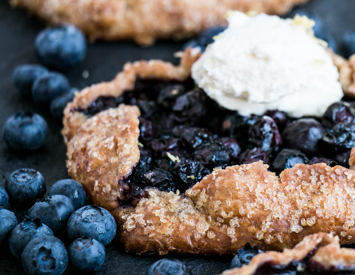 Blueberry Galette with a scoop of lemony whipped mascarpone on top.