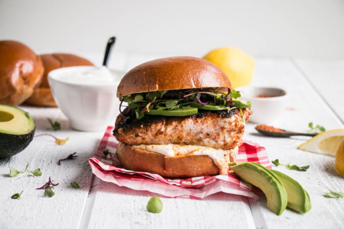 Blackened Harissa Halibut Burger is a dream of a fish burger. Perfectly spiced with a harissa blackened halibut burger, with a cooling lemon yogurt, all on a delicious brioche bun.