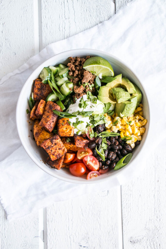 Easy, delicious, and vibrant Sweet Potato Taco Bowl! Take taco night up to the next level with this delicious and healthy meal! #healthy #tacos #sweetpotatoes #recipe