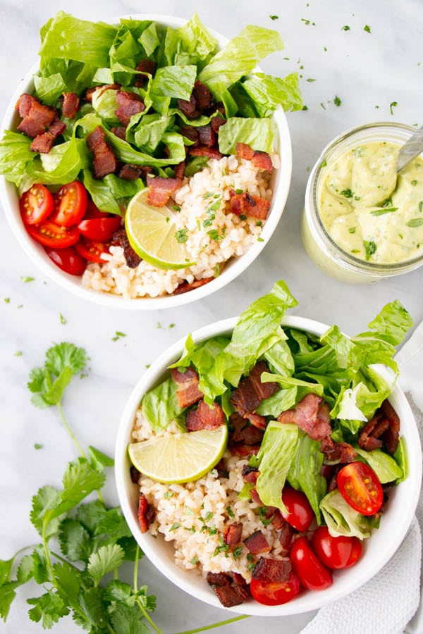 BLT Rice Bowl recipe with a thick Avocado Lime Dressing in a white bowl