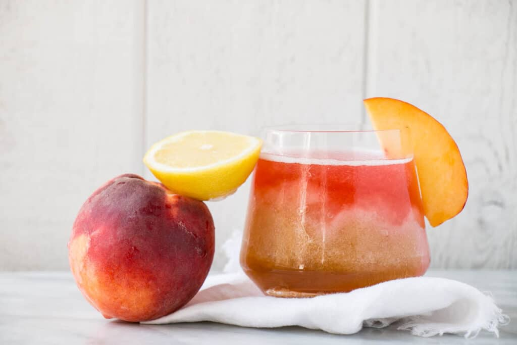 Spiked Peach Iced Tea | My Kitchen Love. Refreshing, fruity, and so delicious, this Spiked Peach Iced Tea has the perfect amount of Southern charm!