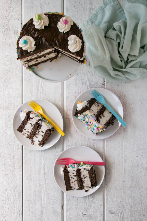 Ice Cream Sandwich Cake with thin brownie cookie layers and chocolate chip ice cream layers.