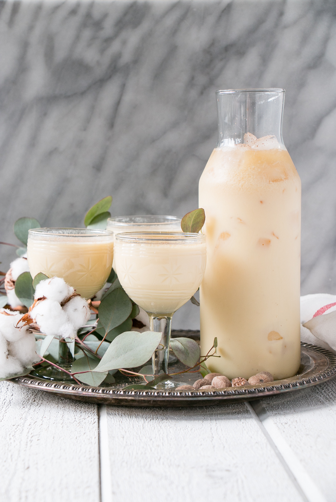 Easy Bourbon Eggnog takes the classic eggnog cocktail and adds the right level of spice and warmth. Top with nutmeg and cinnamon for an indulgent and festive cocktail! #eggnog #cocktail