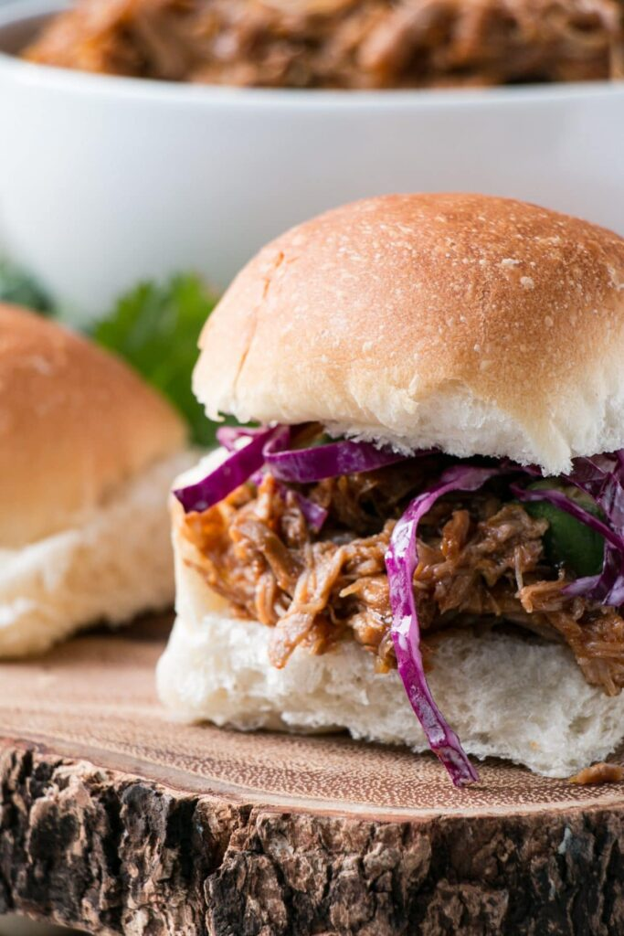 This is the BEST BBQ Pulled Pork with a mouthwatering BBQ sauce and instructions for Instant Pot and Slow Cooker. #instantpot #pulledpork #slowcooker