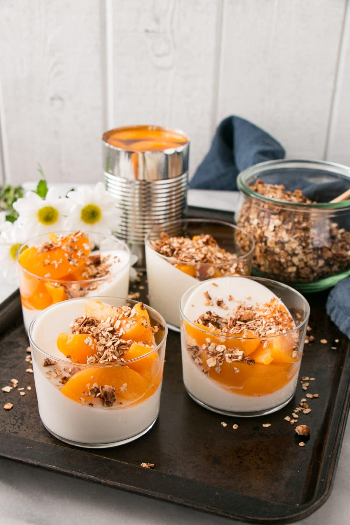Peach Yogurt Panna Cotta with Cinnamon Granola is a dreamy make ahead breakfast that is perfect for entertaining, Mother's Day, Valentine's Day or anytime you need a special treat for breakfast! #ad #breakfast #mothersday #valentinesday #pannacotta