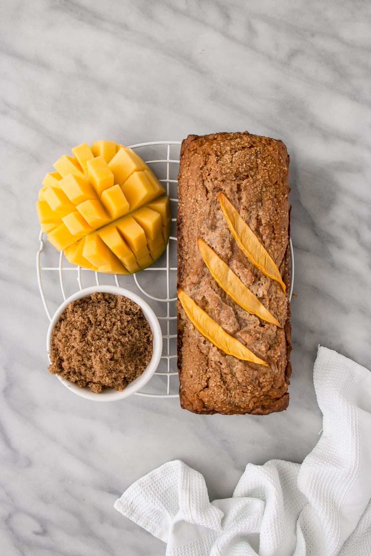 Mango Brown Sugar Bread is a perfectly sweet quick bread. Full of mango and brown sugar flavours. #bread #mango #mangobread #brownsugar