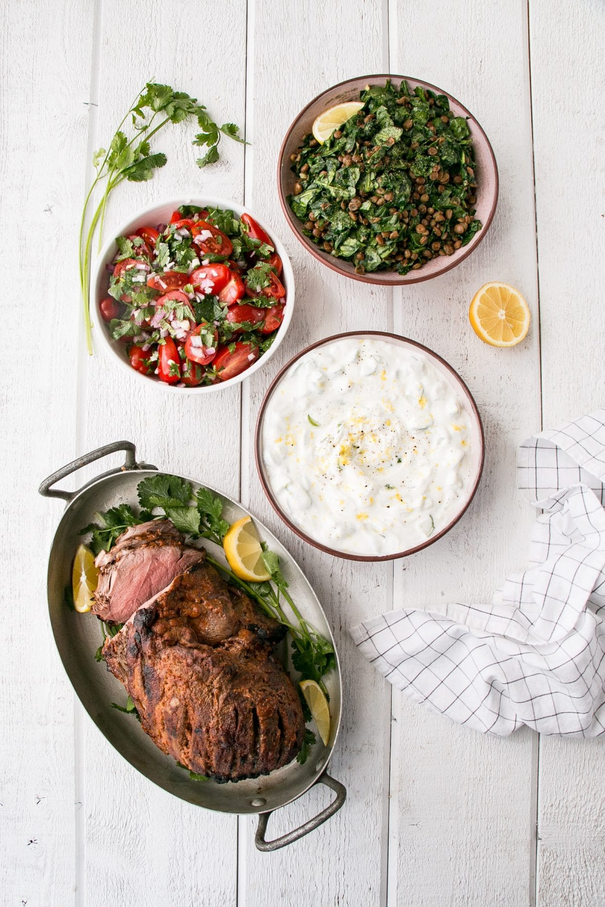 Curry spiced leg of lamb, spinach lentils, tomato salas and lemon yogurt