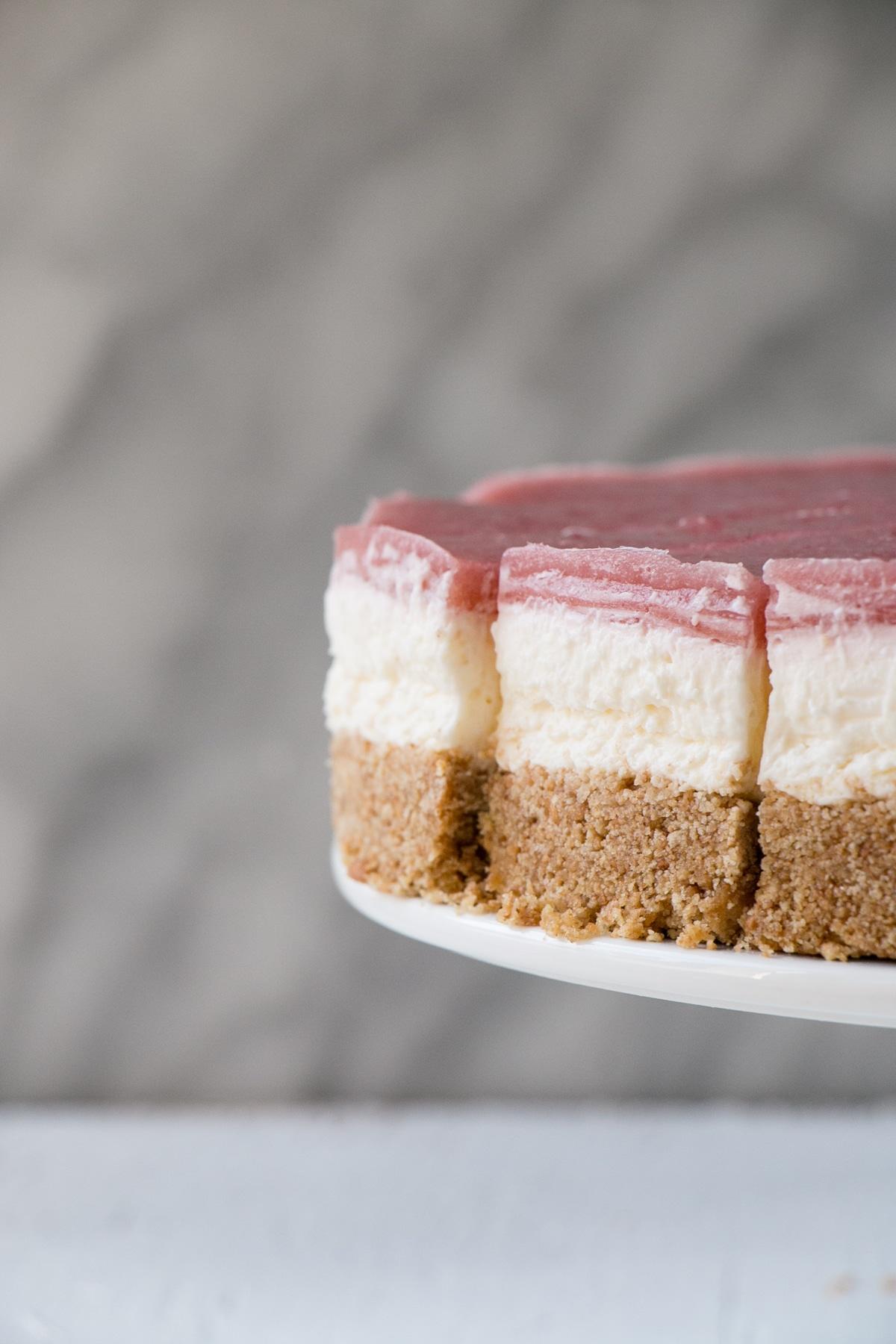 side angle photo showing layers of a No Bake Rhubarb Cheesecake