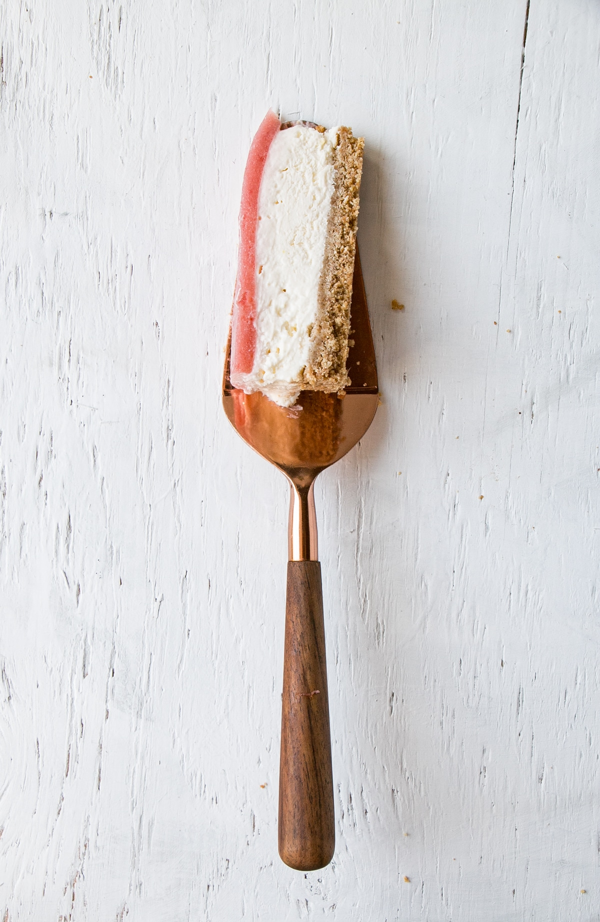 Cut pice on a plate of a No Bake Rhubarb Cheesecake