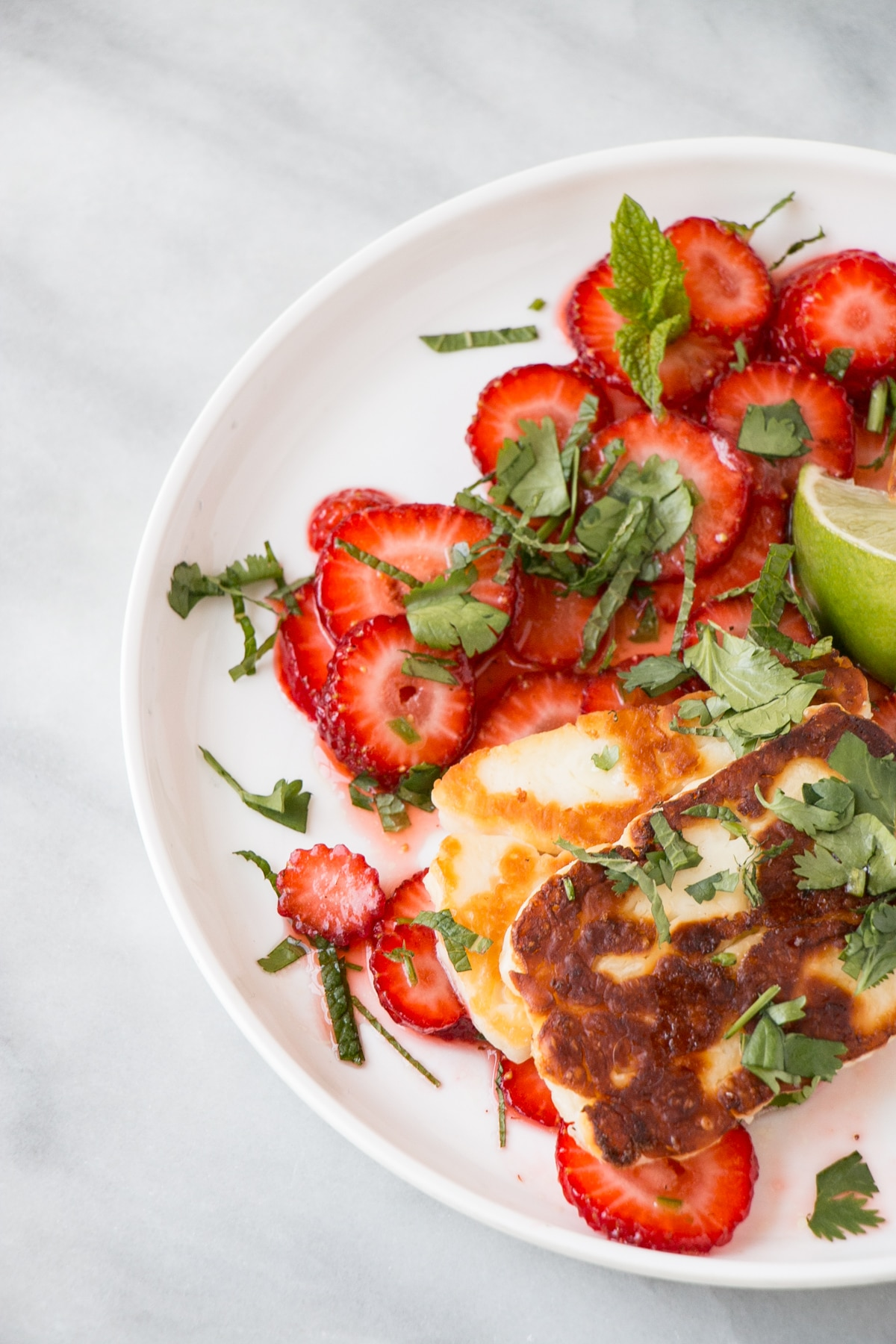 Halloumi and Strawberry Salad on a white plate.