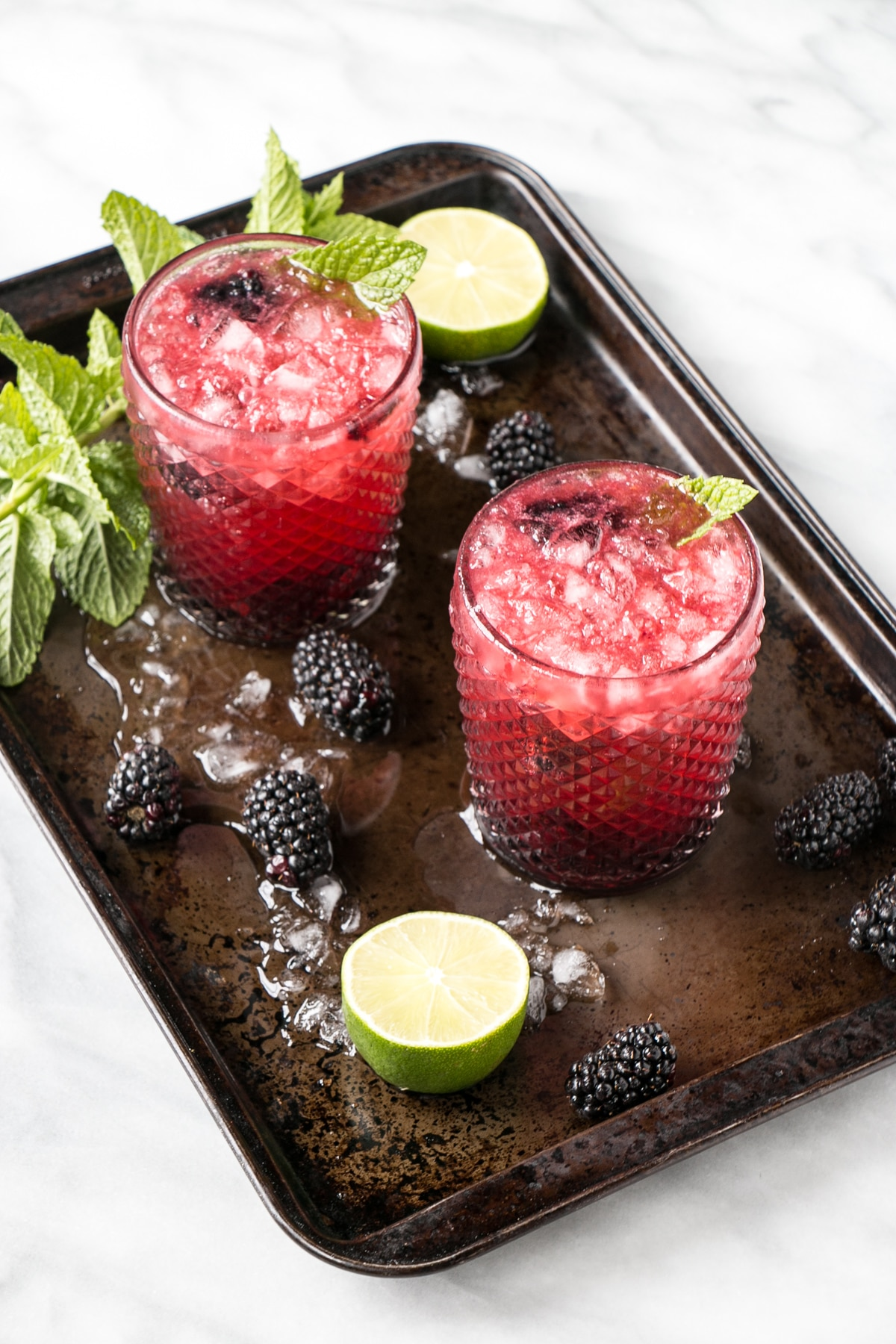 Blackberry Mojito with blackberries limes, and mint.