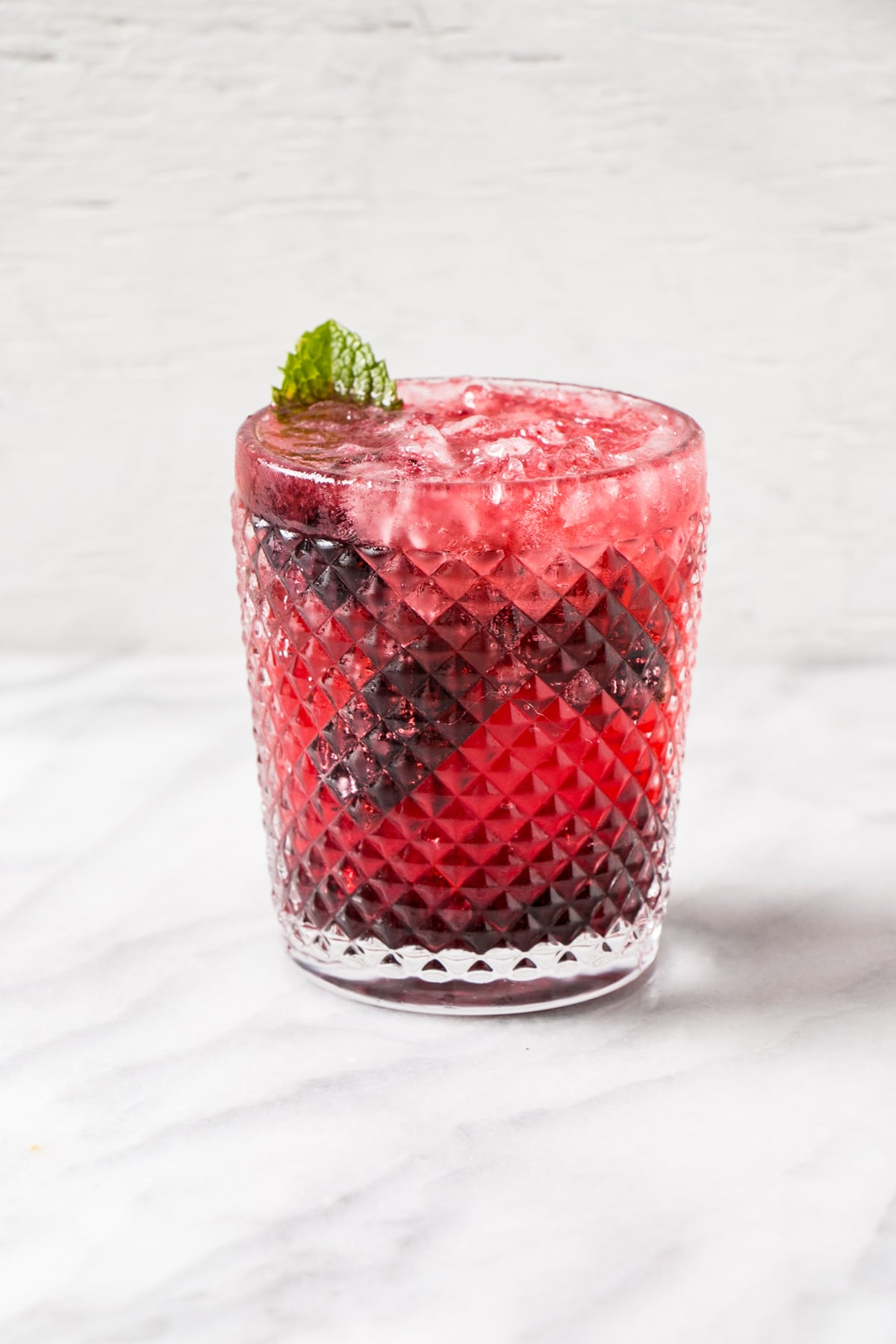 Blackberry Mojito in a textured glass.