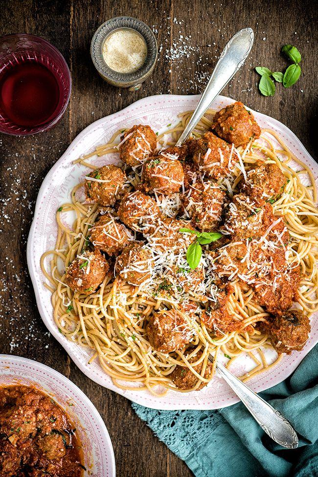 Meatballs in tomato sauce over pasta