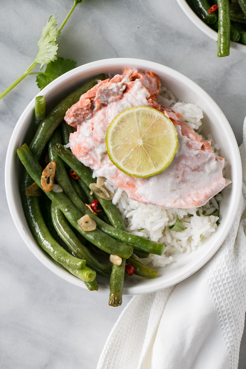 Coconut Lime Salmon with coconut rice and spicy green beans in a bowl