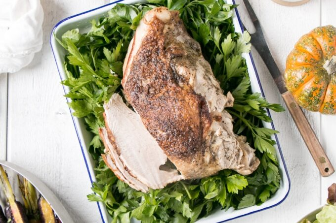 Instant Pot Turkey and Gravy with a turkey breast on top of parsley.