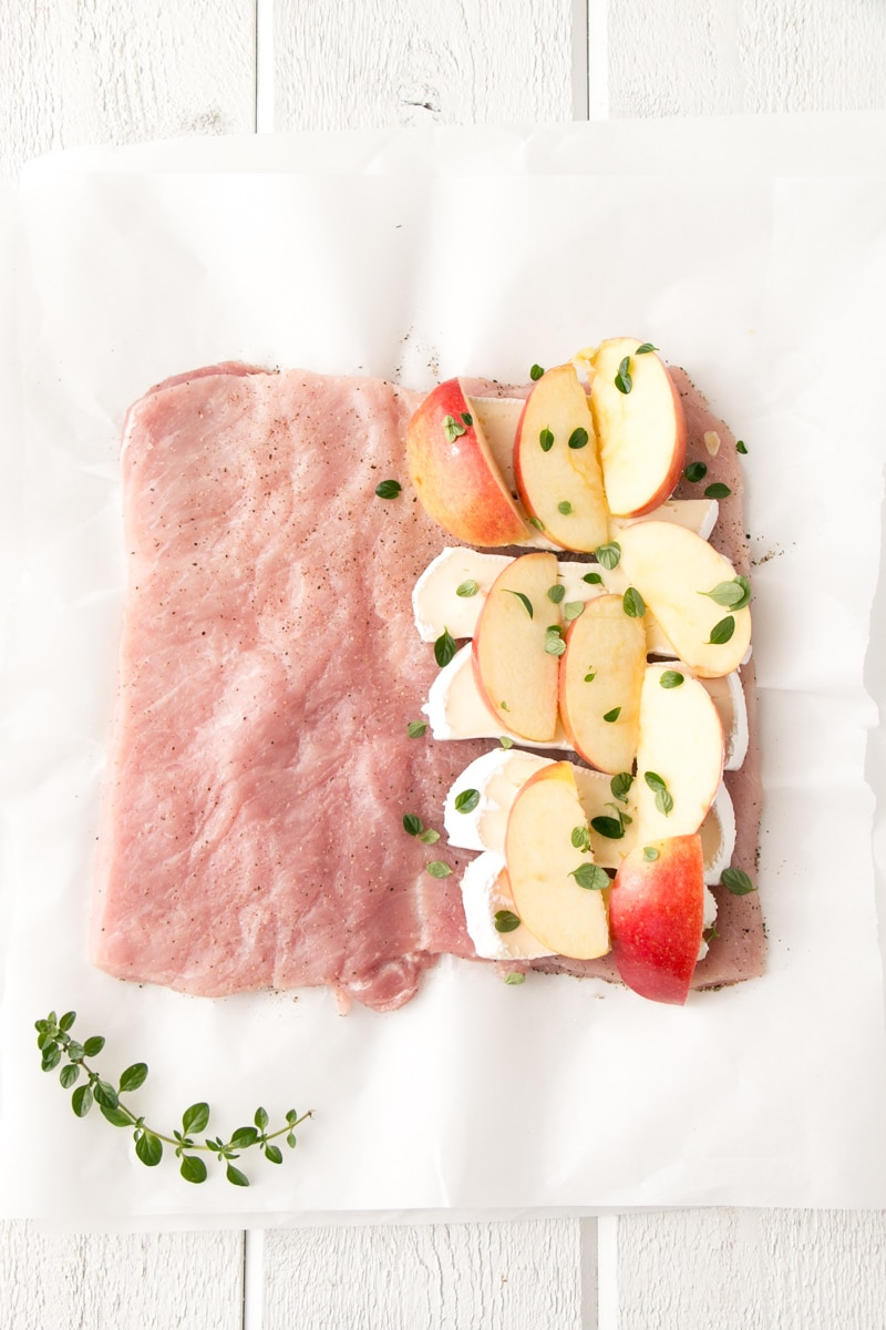 Prepping Apple and Brie Pork Tenderloin with pork loin unrolled.