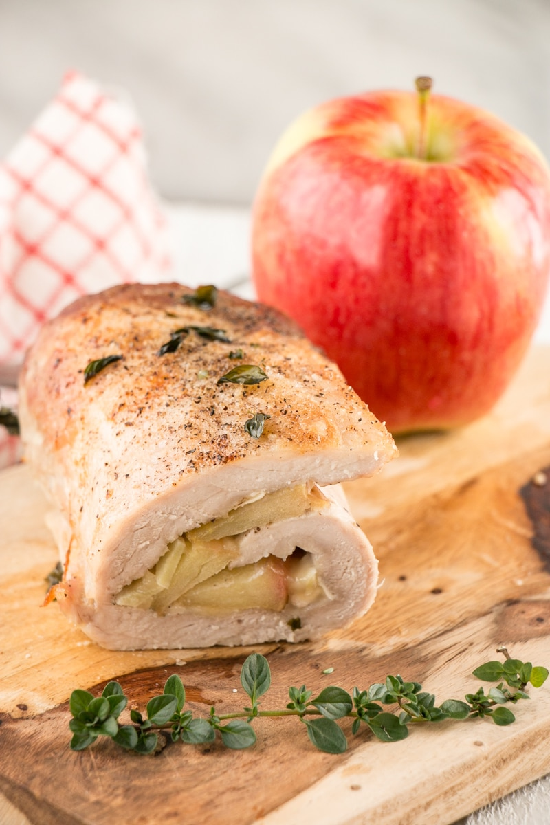 Apple and Brie Pork Tenderloin with an apple in the background
