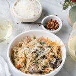 Turkey Tetrazzini with crushed red peppers and grated parmesan cheese