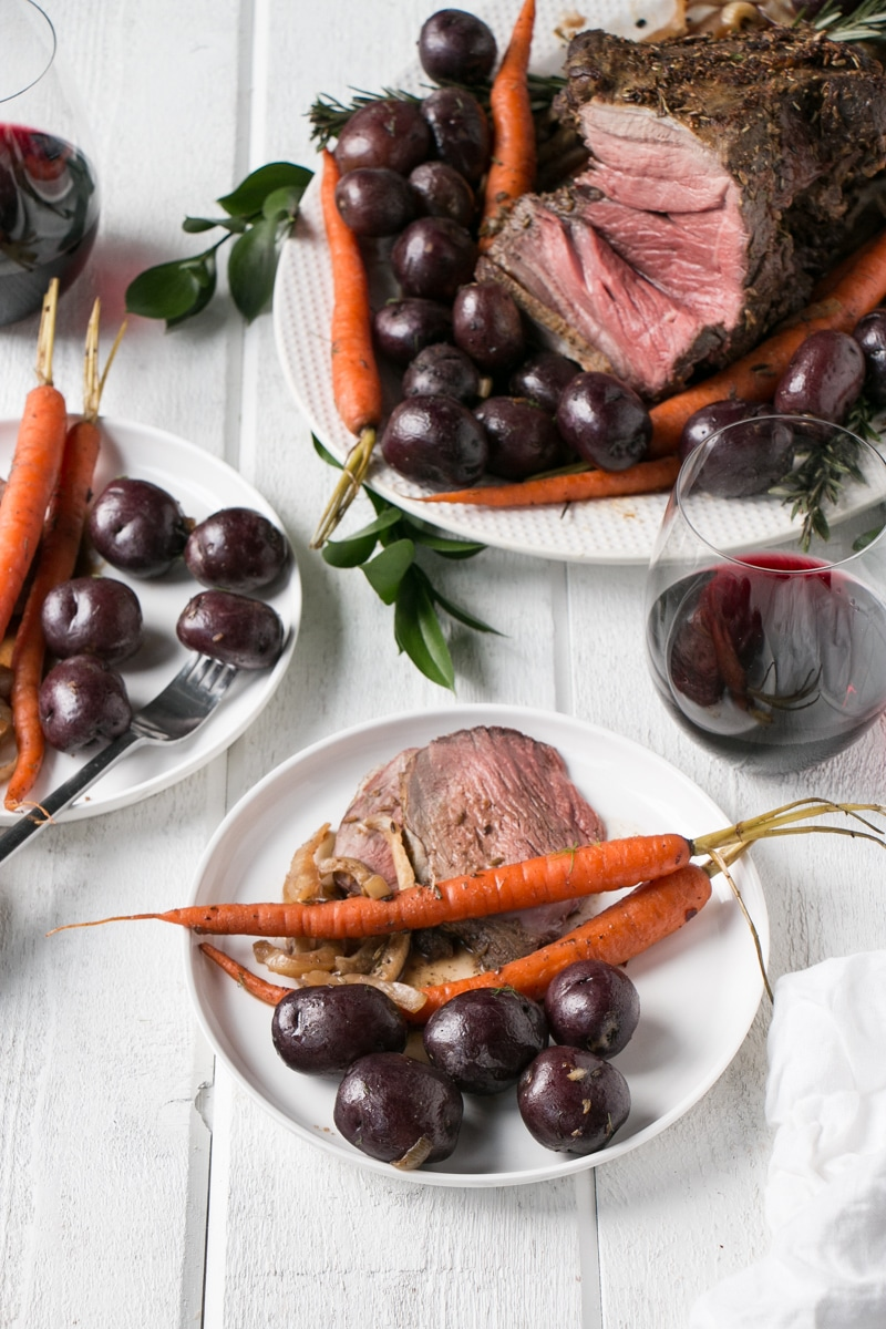 Holiday Lamb Roast sliced with potatoes and carrots