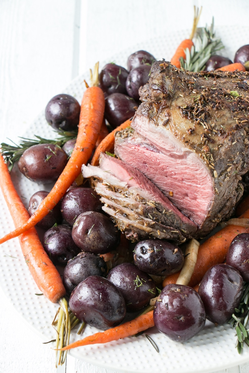 Holiday Lamb Roast on a white serving tray