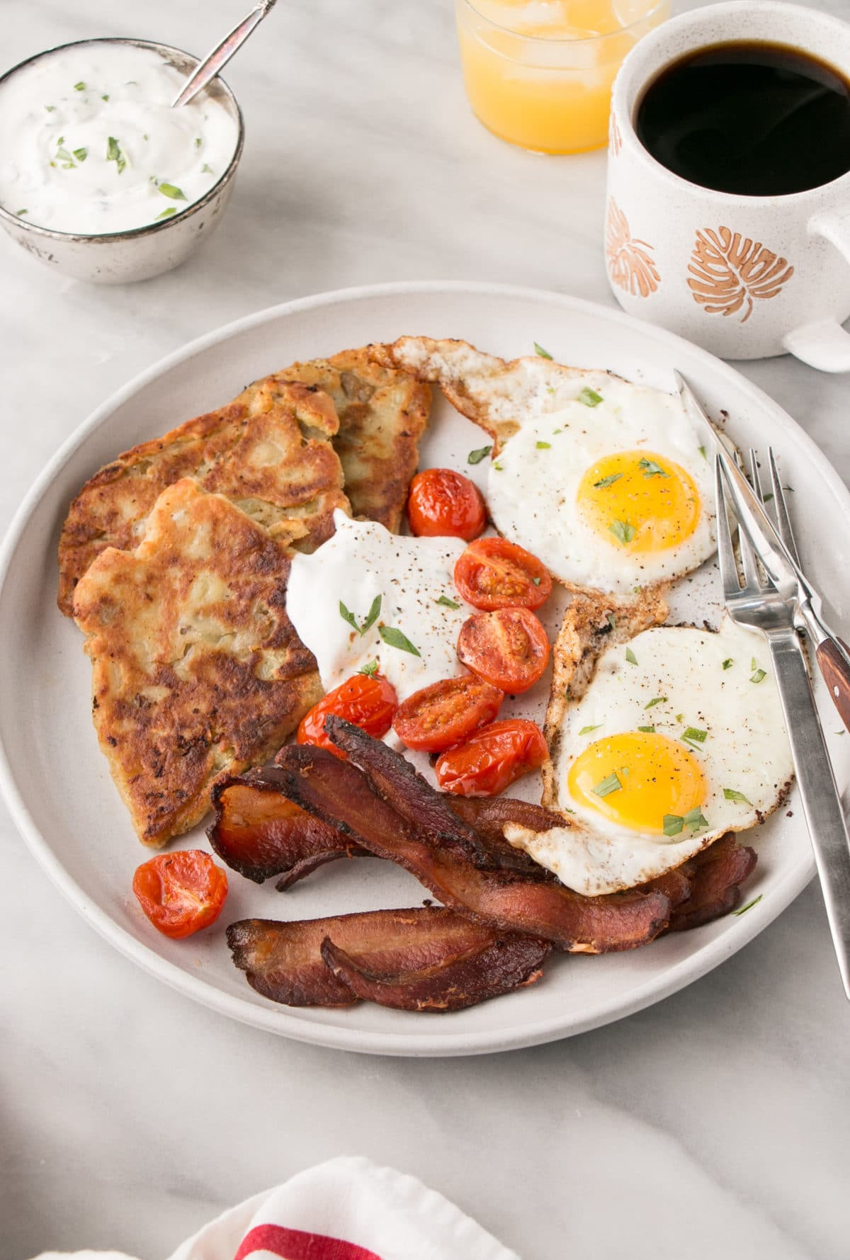 Scottish Potato Scones on a plate with eggs, bacon and tomatoes