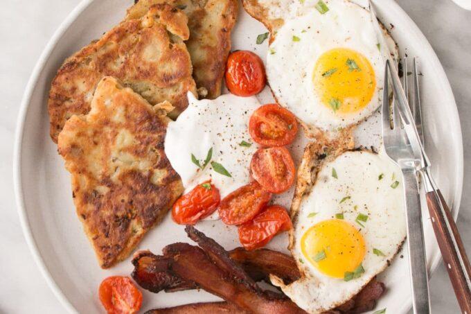 Scottish Potato Scones on a plate w/ a full breakfast