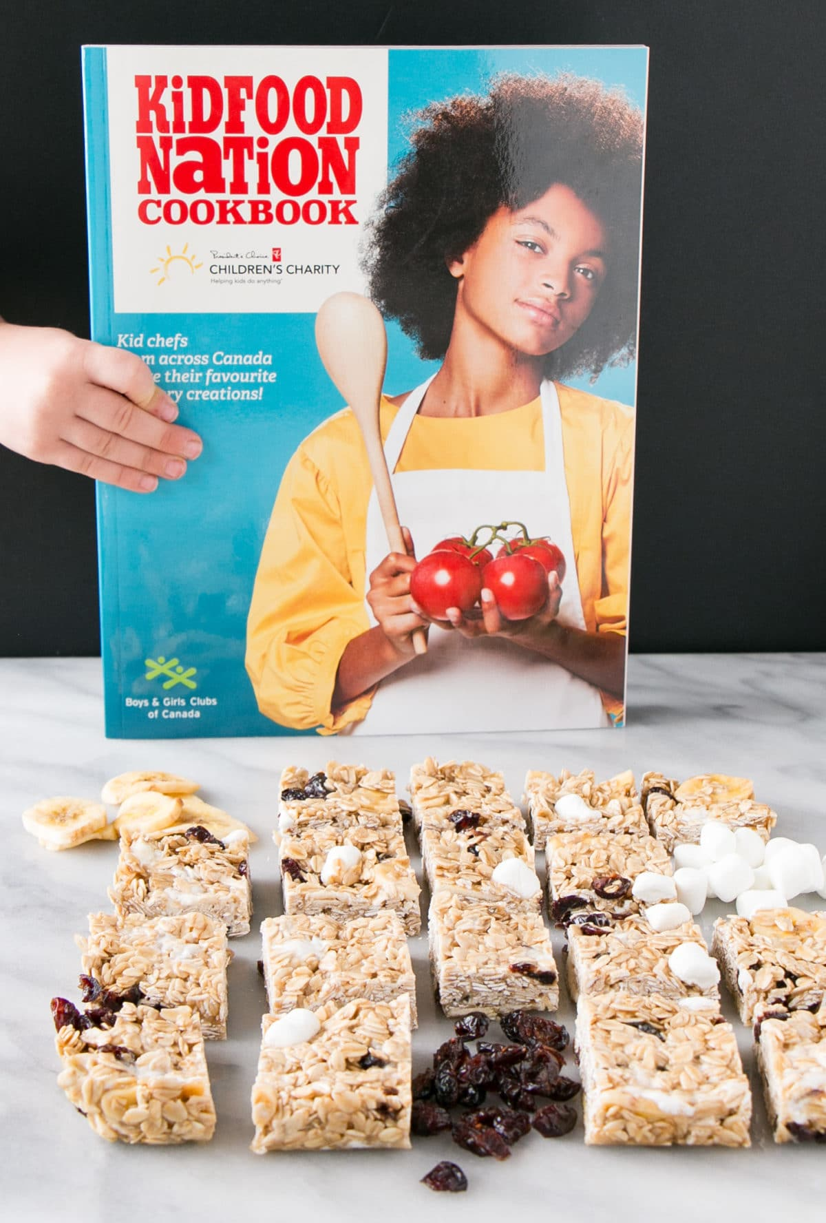 Marshmallow and Dried Fruit Granola cut up w/ Kid Food Nation Cookbook