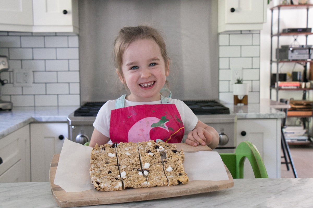 Young girl holding chewy granola bars