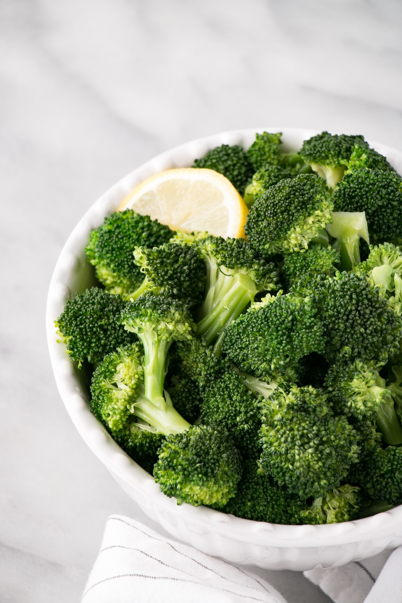How To Steam Broccoli With Cooked In A White Bowl