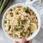 Asparagus and Sundried Tomato Orzo Pasta Salad in a white serving bowl