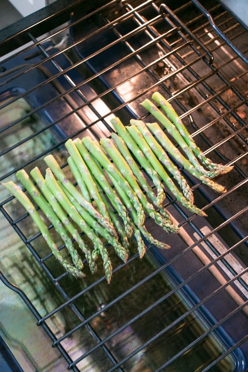 asparagus roasting directly on an oven rack.
