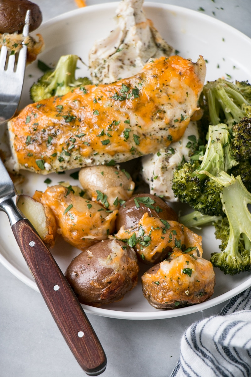 Cheesy Chicken and Potato Bake with broccoli on a plate