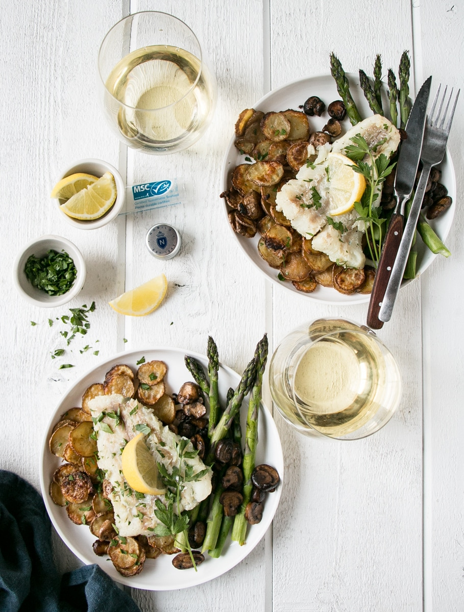 Pan Fried Cod served with potatoes, asparagus and mushrooms.