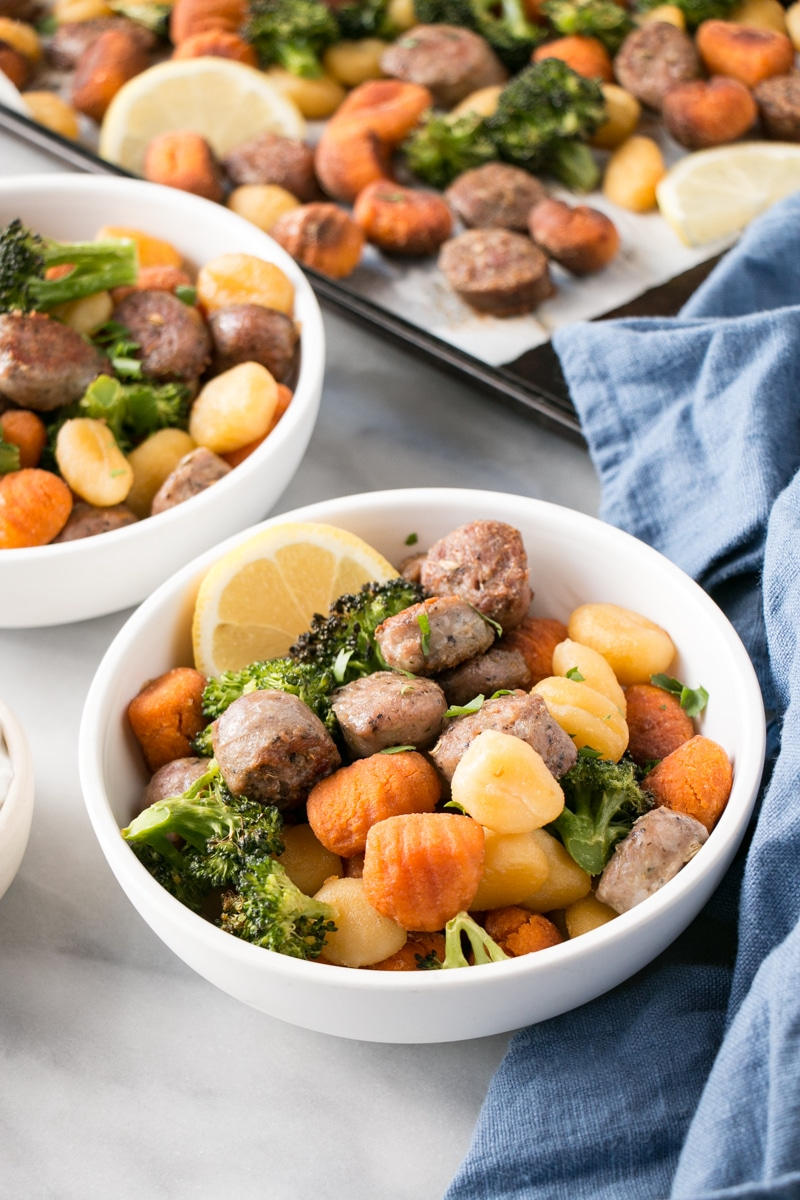 Sheet Pan Gnocchi with Sausage and Broccoli in a white bowl.