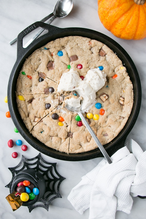 Halloween Candy Skillet Cookie with ice cream on top.