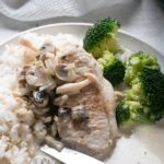 Instant Pot Pork Chops with Creamy Mushroom Gravy with rice and steamed broccoli