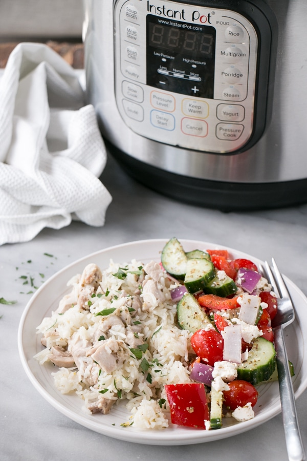 Greek Instant Pot Chicken and Rice with a Greek salad on the side.