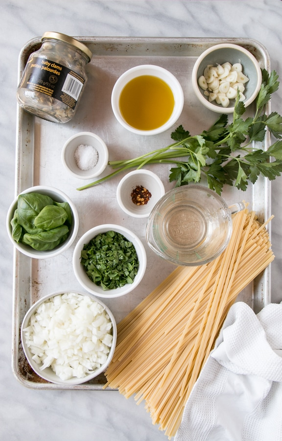 Prep ingredients laid out on a baking tray for Linguine with Clam Sauce