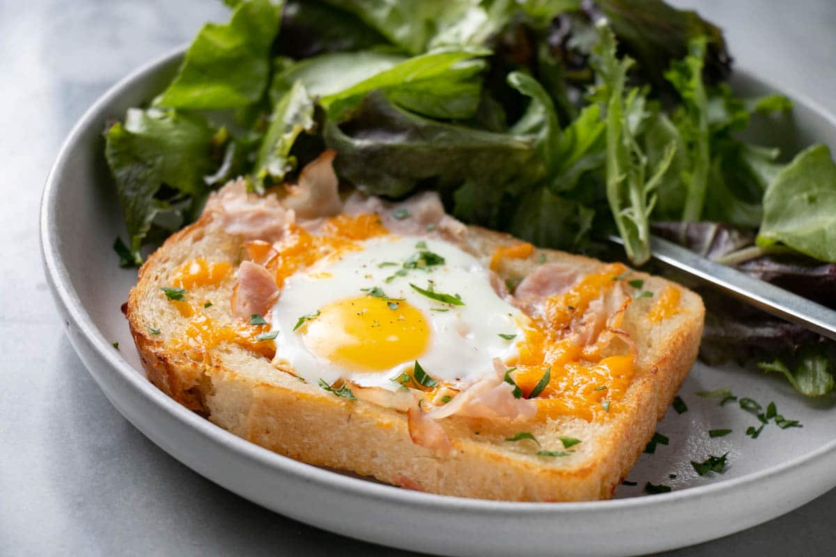 Crispy Ham and melty Cheese Toad in a Hole with a green salad.