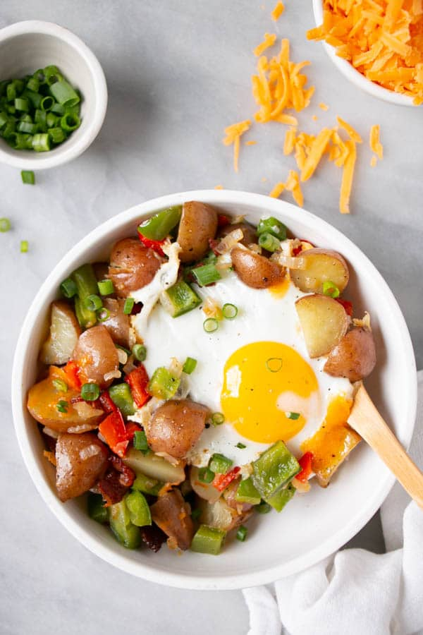 Easy Breakfast Skillet with a bright yellow yolked egg and a colourful veggie mix.